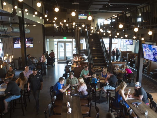 People get a first look at DC Oakes Brewhouse and Eatery, located on E. Harmony Road, on Thursday, May 4, 2017. The brewpub is one of the newest to join the Fort Collins restaurant scene that brought in over $100 million in sales for the first three months of 2017.