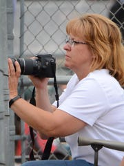 Jill Tomfohrde watches her son Patrick pitch for Pewaukee