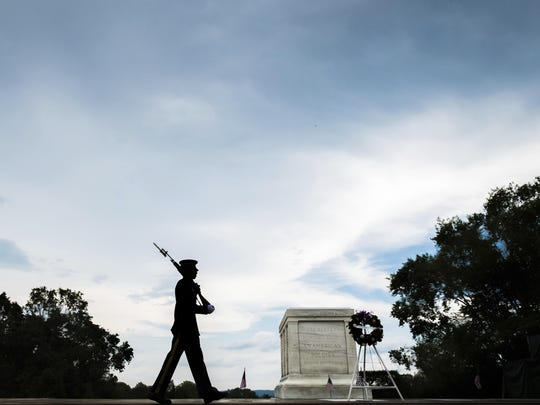 A member of the U.S. Army 3rd Infantry Regiment walks his post in front of The Tomb of the Unknown Soldier in Arlington National Cemetery during the Memorial Day weekend in Arlington, Va., Sunday, May 27, 2018.