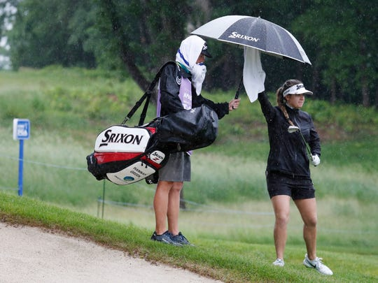 Hannah Green dries her club with a towel on the 17th hole during the first round of the KPMG Women's PGA Championship.