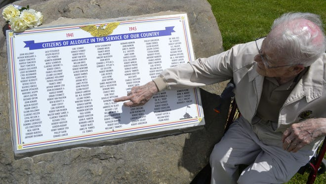 Richard Gay, 91, points to his name on a new marker in Green Isle Park in Allouez that honors the men and women from Allouez who had military service during World War II. The sign with almost 200 names is a replica of a billboard that was displayed in Allouez during the war in the 1940s.