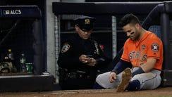 Houston Astros' Jose Altuve sits near the dugout during