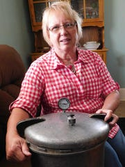 Frieda Fought has a collection of pressure canners, including her grandmother's canner with wooden handles.