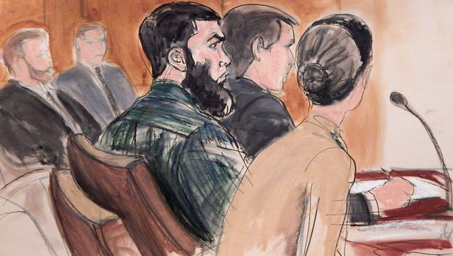 In this courtroom sketch, Abid Naseer, center, is flanked by his team at the defense table, Feb. 18, 2015, in federal court in the Brooklyn borough of New York.