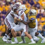 Advertiser photo by Buddy Delahoussaye--LSU Tigers defensive end Arden Key (49) sacks  Bulldogs quarterback Nick Fitzgerald (7) during the first half of a SEC game between Mississippi State and the LSU Tigers in Death Valley on Saturday Sept. 17, 2016.