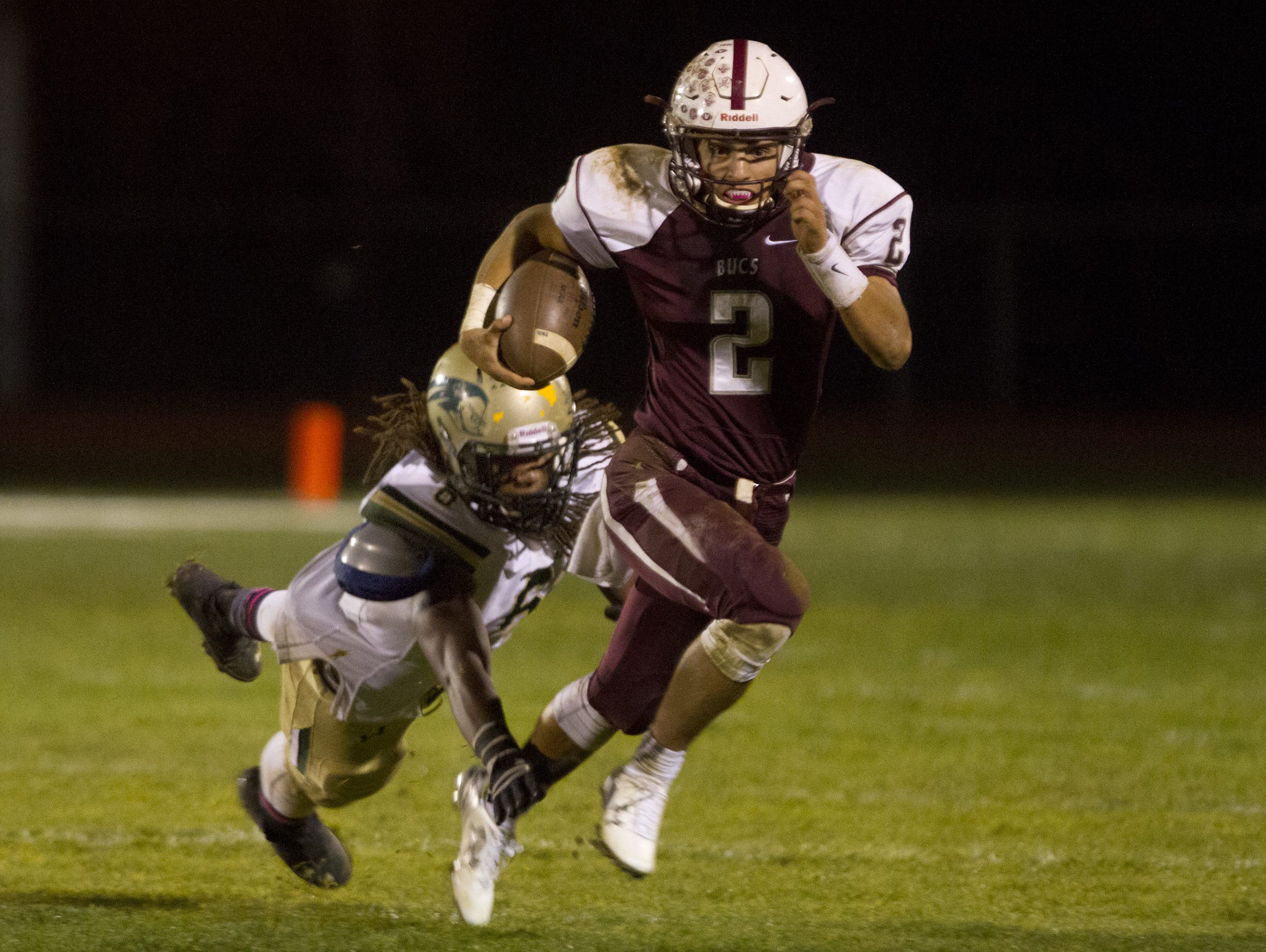 Red Bank Regional senior quarterback Jack Navitsky, shown breaking away for the winning touchdown in the Bucs' win over Red Bank Catholic on Oct. 16, has been among the team leaders for Red Bank during its magical season.