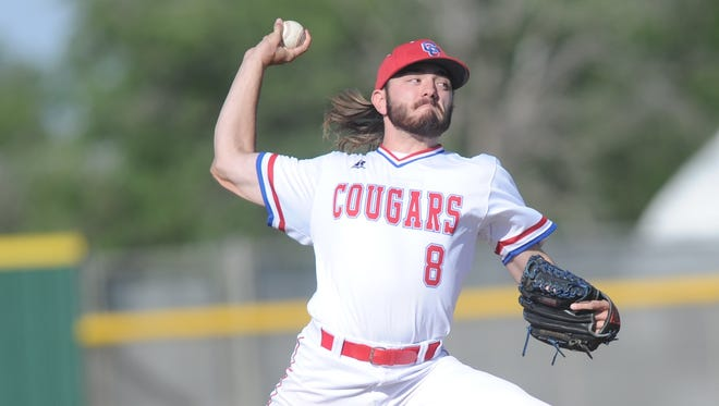 Cooper pitcher Reid Watts throws a pitch against Canyon in Game 1 of the Cougars' bi-district series May 5, 2017 in Lubbock.