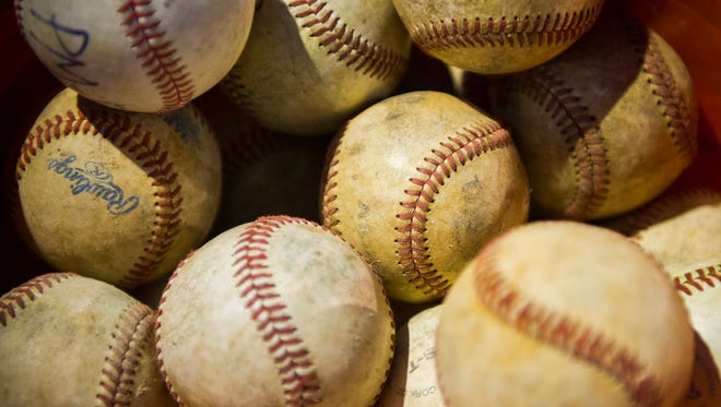 A bucket of baseballs sits on the field during game between the Southern Indiana Shockers and the McCutchanville Mud Dogs on the Mickey Martin baseball field at McCutchanville Community Park in Evansville,  Thursday, Oct. 13, 2016. The Mickey Martin baseball field could be in jeopardy as the Evansville Vanderburgh School Corp. finalizes plans for a new North Side elementary school.