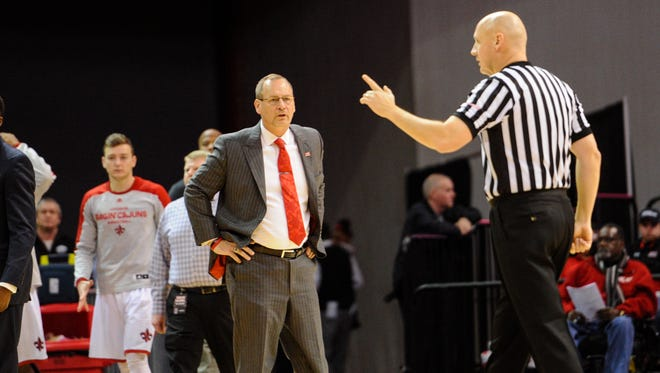 UL coach Bob Marlin reacts to a call in last Saturday night's 88-65 win over Troy. Jan 23, 2016.