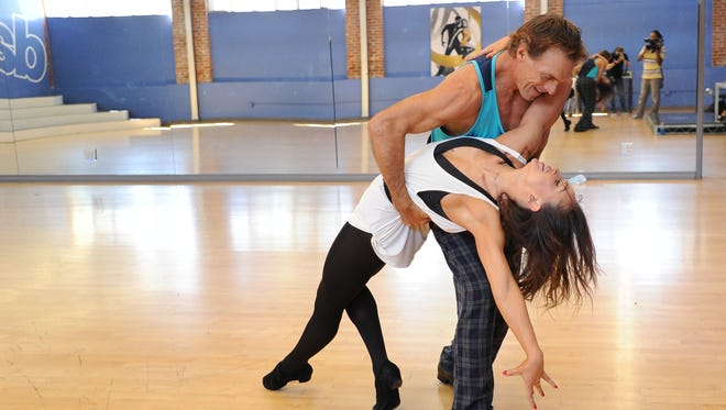 """The celebrity cast of """"Dancing with the Stars"""" is lacing up their ballroom shoes and getting ready for their first dance on March 21. Shown is NFL football player Doug Flutie and Karina Smirnoff."""