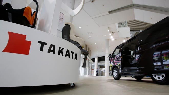 U.S. officials intensified a probe of faulty Takata air bags, demanding documents back to 1998 from Honda, a main customer, and back to 2000 from Japan-based Takata. Pictured is a Toyota showroom in Tokyo.