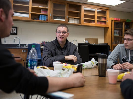Chris Lawery, 18, speaks with classmates Kyle Pond,