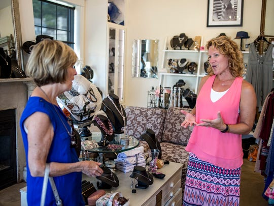 Marcella Costin, right, talks with customer Sharon