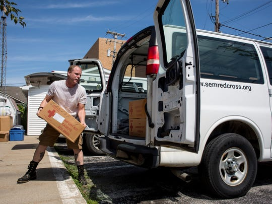 Franklin Dickerson, a volunteer with the Detroit chapter, loads supplies into a van Wednesday, August 24, 2016 at the American Red Cross St. Clair County Chapter in Port Huron. The Red Cross is closing the location and the building has been put up for sale.