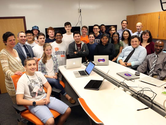 Technology director Erica Beasley, left, with the students that were trained as Apple technicians and staff at Briarcliff Manor High School.