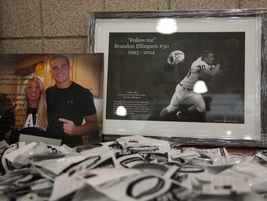 Photos and wrist bands honoring of Brandon Ellingson