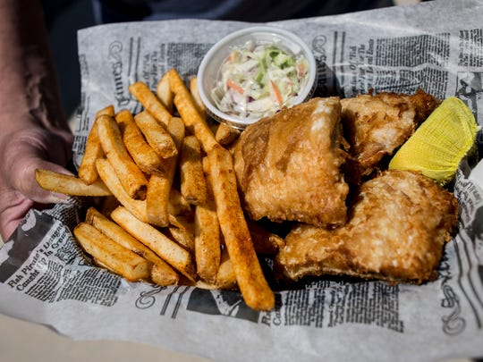 Joe and Debbie Ziegler of St. Clair show their order of fish and chips Monday, June 19, 2017 at The Wicked Fish at Vantage Point in Port Huron.