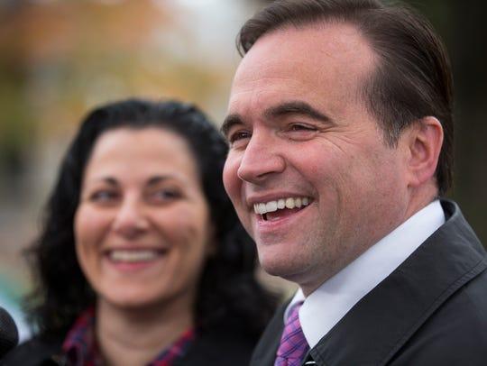 Mayor John Cranley, and wife, Dena, talk with the media