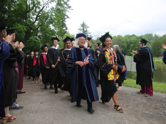 Students walk into the commencement ceremony on Sunday,