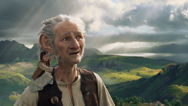 "Sophie (Ruby Barnhill) hitches a ride with The BFG (Mark Rylance) in Steven Spielberg's ""The BFG."""