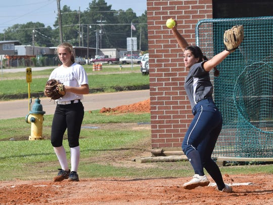 Allie Hutton (left) of Archibishop Hannan and Cameron Crochet of Lafayette's Cajun Express practice pitching at the Louisiana College Elite Softball Clinic held Tuesday.