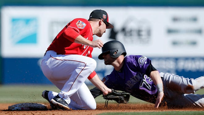 Cincinnati Reds shortstop Phil Gosselin (46) tags out Colorado Rockies second baseman Shawn O'Malley (73) in the top of the fourth inning of the Spring Training game between the Cincinnati Reds and the Colorado Rockies at Goodyear Ballpark in Goodyear, AZ, on Saturday, Feb. 24, 2018.