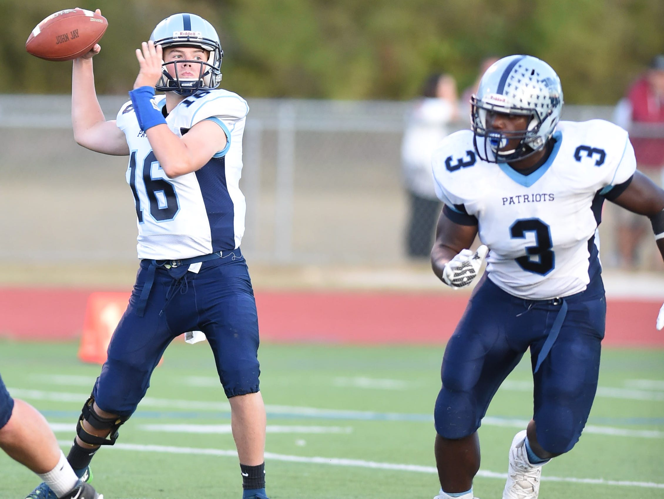 From right, John Jay's Calvin Anthony covers quarterback, Richie Eletto during a game versus Arlington High School on Friday September 16, 2016.