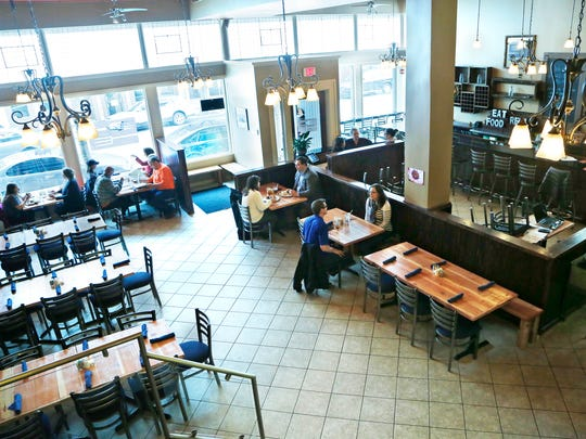 The dining room begins to fill at the noon hour Friday, March 20, 2015, at Restauration, 731 Main Street in downtown Lafayette.