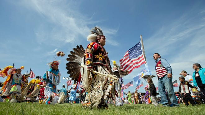 Members of the Standing Rock Sioux Tribal Nation, dance 4 during a Cannon Ball flag day celebration in 2014.