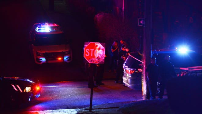 In this March 9, 2016 file photo, police investigate the scene after a deadly shooting in Wilkinsburg, Pa. Pittsburgh television station WTAE said Wednesday, March 30, 2016, it has ended its relationship with anchorwoman Wendy Bell over racial comments she posted on Facebook about an ambush shooting at a cookout that left five people and an unborn baby dead.
