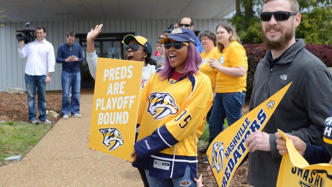Fans cheer the Nashville Predatorsas the team leaves for its first-round playoff series with Anaheim.