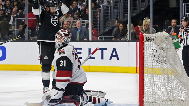 Los Angeles Kings right winger Dustin Brown celebrates a goal by Jake Muzzin against Arizona Coyotes goalie Scott Wedgewood during the second period of an NHL hockey game in Los Angeles Saturday, Feb. 3, 2018. (AP Photo/Reed Saxon)