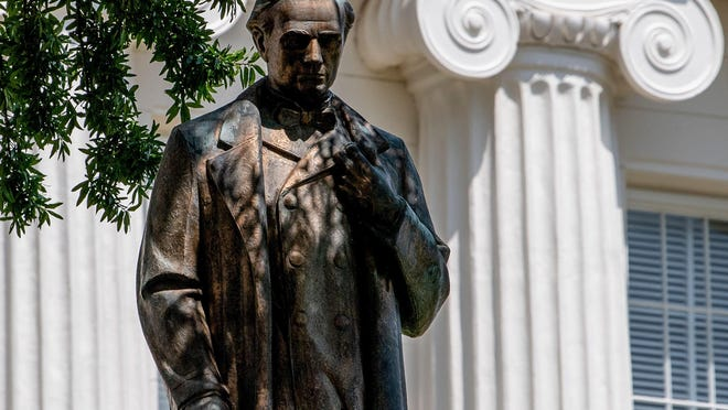 The statue of Dr. J. Marion Sims on the grounds of the Alabama State Capitol Building is shown June 1. {Mickey Welsh/The Montgomery Advertiser]