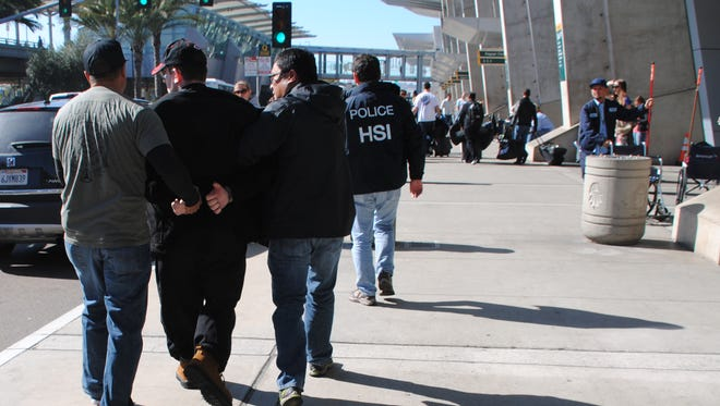 In this Friday, Jan. 29, 2016 photo provided by the U.S. Immigration and Customs Enforcement (ICE), former Columbus, Ohio, seminarian Joel Wright, second left, is arrested at in San Diego on federal charges for allegedly seeking to have sex with infant and young girls in Mexico.