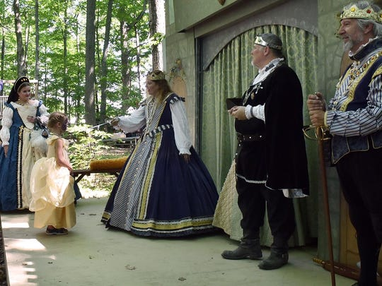 Lorelei Stuebner of Wrightstown is proclaimed a future lady in waiting by Queen Catherine (Lynne Melssen of Ames, Iowa) during a ceremony in the Kids Kingdom at last year's Door County Renaissance Faire.