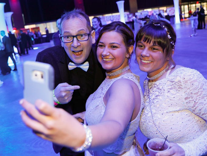 Prom goers enjoy themselves at the Smiley Prom 99.5