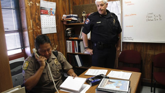 Shiprock Police District Lt. Phillip Joe, left, and Farmington police Chief Steve Hebbe prepare for a ride-along at the Shiprock Police Station on Aug. 7, 2014. Joe is the highest ranking officer in the Shiprock Police District after Capt. Ivan Tsosie was placed on administrative leave.