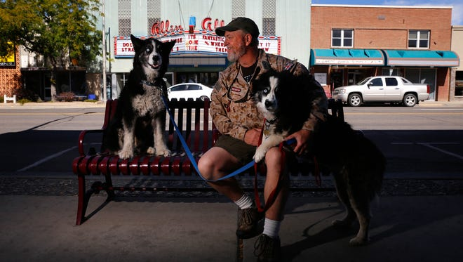 Craig McClure poses for a portrait with his dogs Moose, left, and Chosposi Tuesday during a visit to Farmington to draw attention to the nonprofit group Concerned Veterans for America.