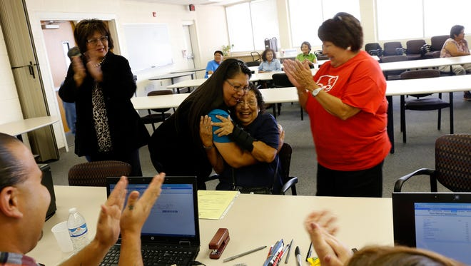 Nancy Joe hugs her mother, Bessie Paul after she completing her paper work for a birth certificate, Thursday, Sept. 22, 2016 at the Northern Navajo Agency Nataani Nez Complex in Shiprock.