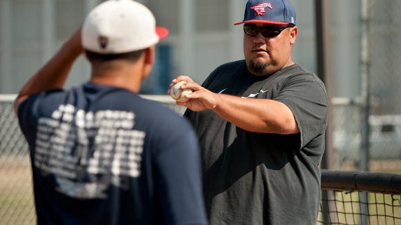 Tulare Western baseball coach Justin Cuellar works with pitchers during a Tulare Western practice. Cuellar spent a year each at Pepperdine and College of the Sequoias before landing at Fresno State in his junior and senior seasons under legendary coach Bob Bennett.