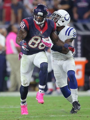 Indianapolis Colts Vontae Davis knocks the ball out of the hands of Houston Texans Andre Johnson for a fumble that was recovered by teammate Indianapolis Colts Mike Adams. The Colts won 33-28 over the Houston Texans at NRG Stadium in Houston on Thursday, October 9, 2014.