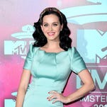 Katy Perry poses at the 2013 MTV Europe Music Awards, in Amsterdam, Netherlands.