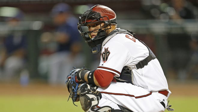 Arizona Diamondbacks catcher Welington Castillo looks towards the dugout before a pitch against the San Diego Padres in the third inning at Chase Field September 14, 2015.
