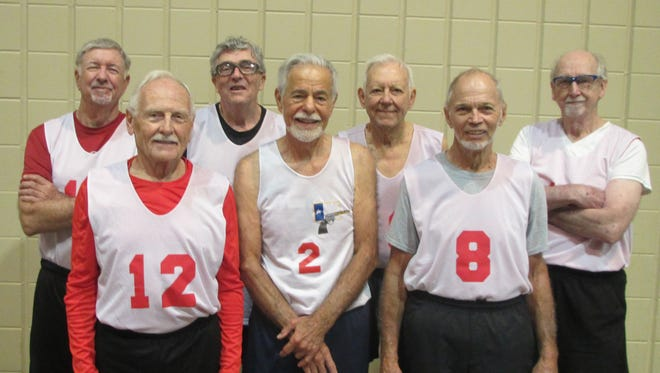 Naples residents Warren Chichester (front row, far right) and Don Harmon (back row, far left) won gold medals at the National Senior Games in Birmingham, Alabama, last week. The basketball players were part of a 3-on-3 team from Iowa in the age 80-85 division.