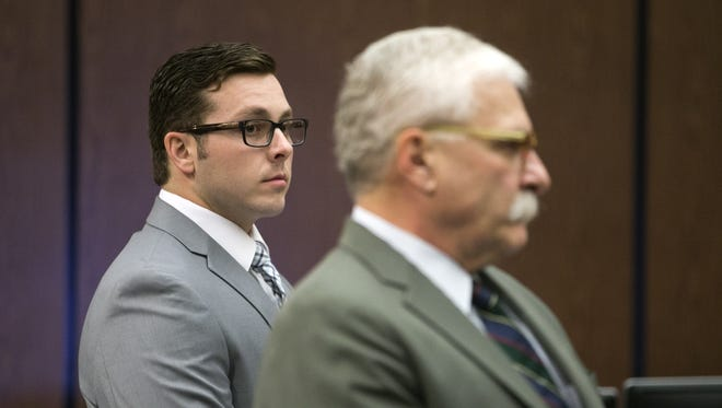 """Former Mesa police Officer Philip """"Mitch"""" Brailsford (left) and his attorney, Mike Piccarreta, stand for the jury at the start of Brailsford's second-degree murder trial in Maricopa County Superior Court in Phoenix on Oct. 25, 2017."""