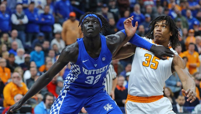 Kentucky forward Wenyen Gabriel (32) and Tennessee forward Yves Pons (35) battle for position under the basket during the first half Sunday.