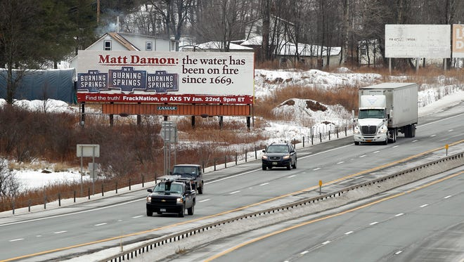 Matt Damon and his latest Hollywood movie, Promised Land, were under fire on a billboard in upstate New York.