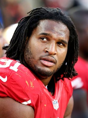 FILE - This Nov. 23, 2014,  file photo shows San Francisco 49ers defensive tackle Ray McDonald (91) on the bench during the fourth quarter of an NFL football game in Santa Clara, Calif. Police say Chicago Bears defensive end McDonald has been accused of domestic violence in Northern California, the latest arrest for the former San Francisco 49er. McDonald was taken into custody Monday, May 25,  2015, on suspicion of domestic violence and child endangerment.