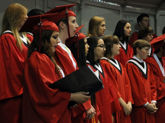 Wichita Falls High School graduates and members of the A Capella Choir sing during the benediction at the 2016 commencement ceremony at Kay Yeager Coliseum.