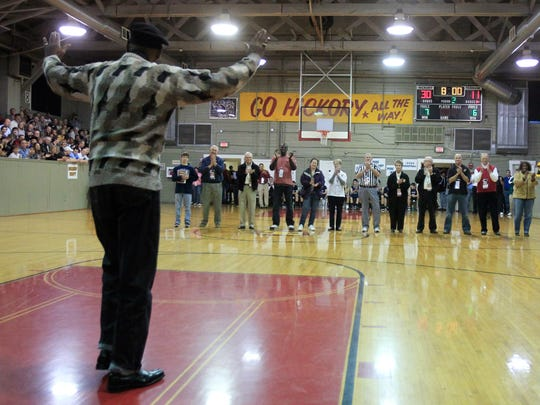 Cleveland Harp, left, waves to the crowd at the Hoosier Gym as he is introduced with other notables at halftime of the Brebeuf vs. Oldenburg game, Dec. 28, 2011.